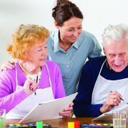Nursing home: Senior couple painting with water colors