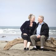 A senior couple sitting on the beach