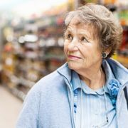 Senior woman looking confused in a store