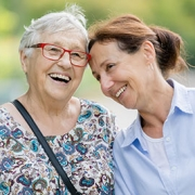 Senior woman laughing with caregiver