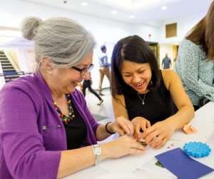 Volunteer doing crafts with residents
