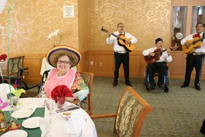Mariachi band and woman wearing sombrero