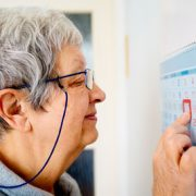 senior woman looking at a calendar