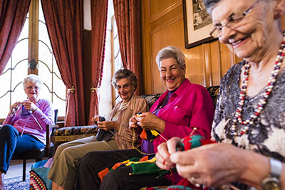 a group of senior women knitting