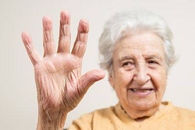 Senior woman raising her hand