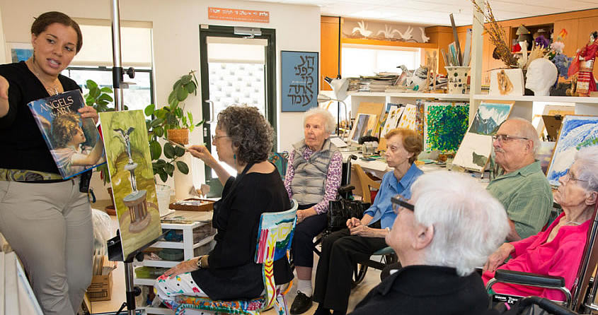 Residents in an art class at The Reutlinger Community