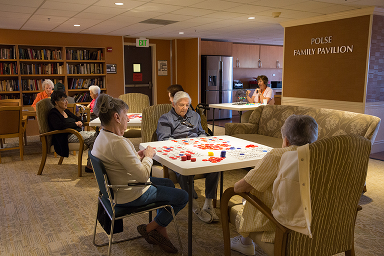 Residents playing bingo in the activity room